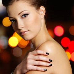 beautiful young woman with black nails