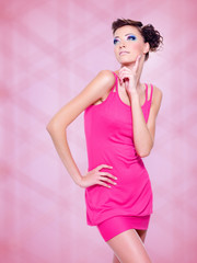 beautiful woman in pink dress with fashion makeup