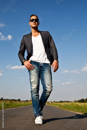 Portrait of  a beautiful young man outdoors