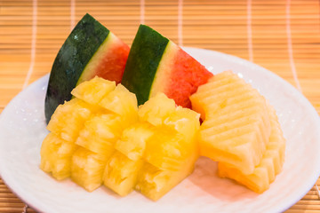 assorted fruit on white plate