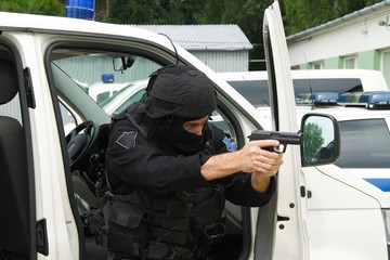special police unit, a man with a gun