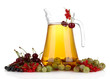 Glass pitcher of compote with different summer berries isolated