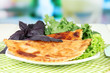 Tasty chebureks with fresh herbs on plate,on  bright background