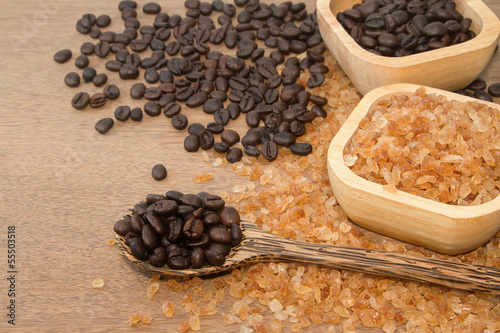 Coffee bean in the wooden spoon and rock candy sugar