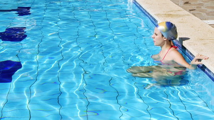 Female swimmer concentrating before race