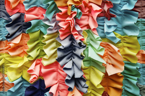 Bright ruffled fabric background close-up