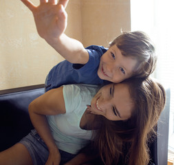 mother with son, happy family at home