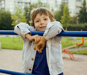 little cute boy on playground outside