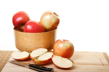 Apples in Bowl and Cut on Cutting Board