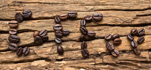 Coffee beans in a letter on the scene.
