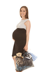 Pregnant black and gray dress hold bag smile