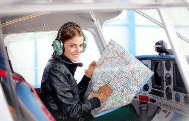 Beautiful woman pilot in a airplane.