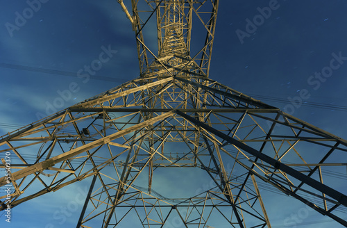 Pylons with electric lines at night