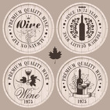 four labels for wine on wooden casks