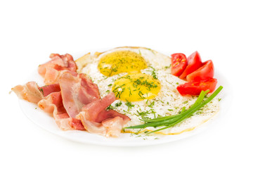 Fried eggs on a plate isolated on white