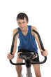 Teenage boy using an exercise bike fitness