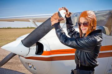 Female pilot  with plane propeller.