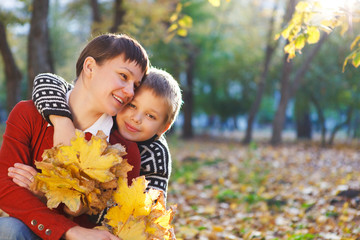 Mother and her son in a autumn park
