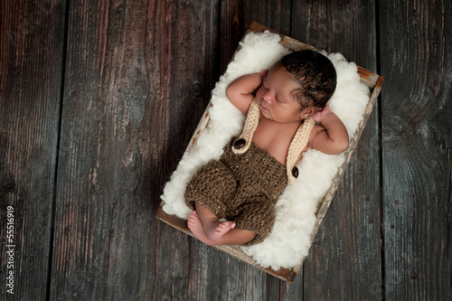Newborn Baby Boy Sleeping in a Rustic Crate