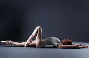 Image of gorgeous ballerina laying in studio