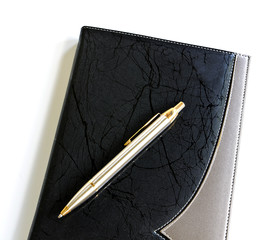 pen lying on a notebook