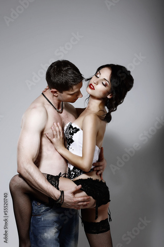 Delicacy. Boyfriend and Girlfriend Embracing in Foreplay Game