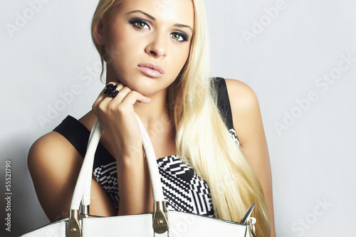 fashionable beautiful blond woman with handbag. beauty girl
