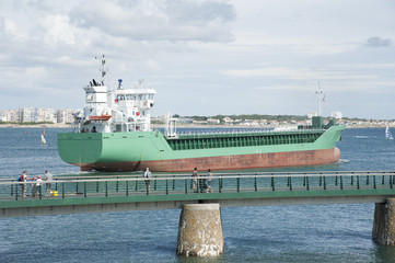 Cargo ship departing port