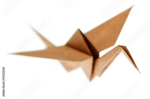 Deurstickers Geometrische dieren Origami crane bird made from brown recycle paper. Isolated on wh