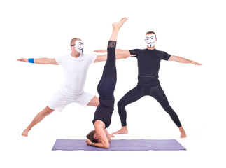 The two masked men and girl doing Yoga exercises