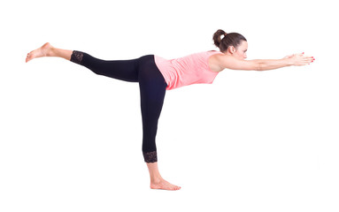 Girl doing  Yoga exercises. Warrior Pose - Virabhadrasana
