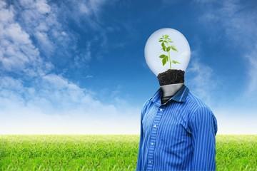 Light man on grass sky background