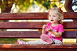 toddler girl on the bench
