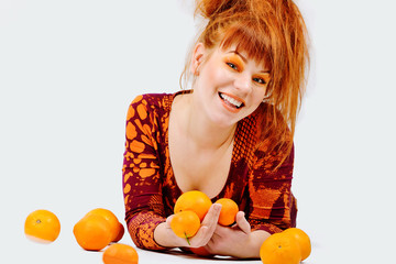 redhead girl with oranges