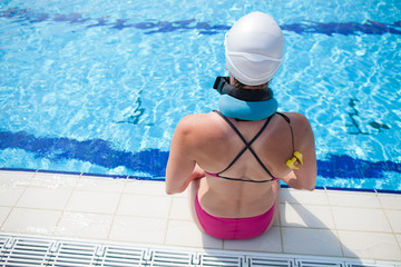 Female swimmer at pool edge