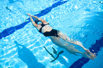 Female freediver diving in pool
