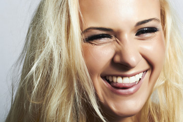 blond woman.mouth and white teeth.smile with tongue