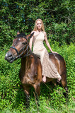Pretty girl on horseback