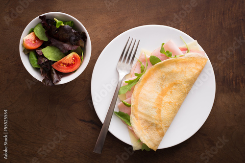 Cheese and ham crepe with salad