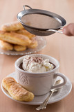 Chocolate cup with whipped cream and ladyfingers