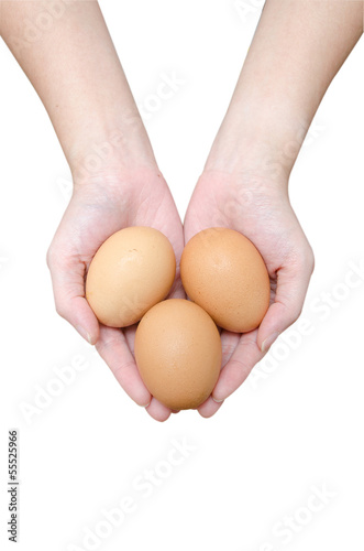 Three eggs in women hands