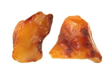 Unpolished amber stone isolated on white