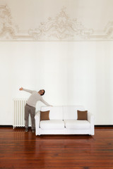 interior home, comfortable white sofa with man