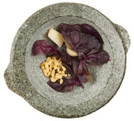 Ingredients of pesto sauce in granite mortar