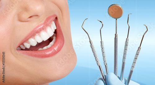 Teeth with dental tools.