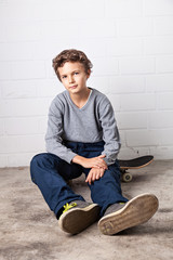 Cool Boy sitting on his skateboard