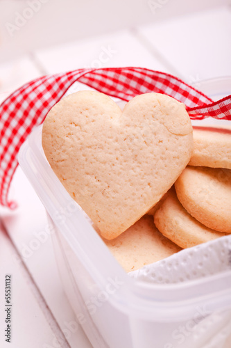 homemade heart cookies on wooden background