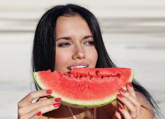 girl eats a water-melon