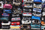 Discarded Junk Cars Piled Up After Crushing poster