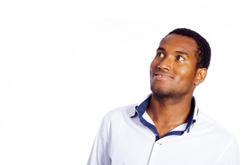 Young man looking up over white background